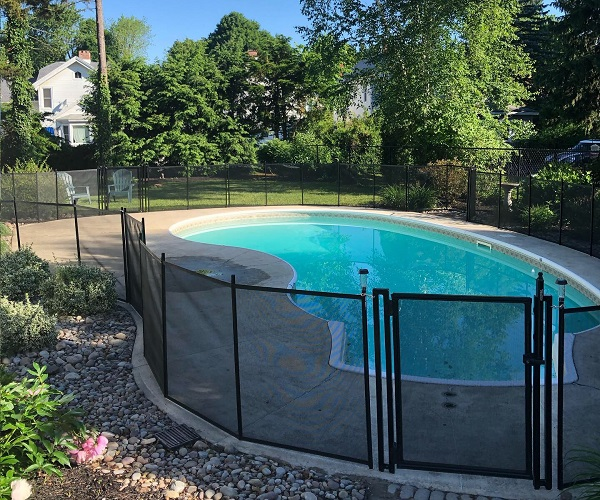 installed black mesh pool fence
